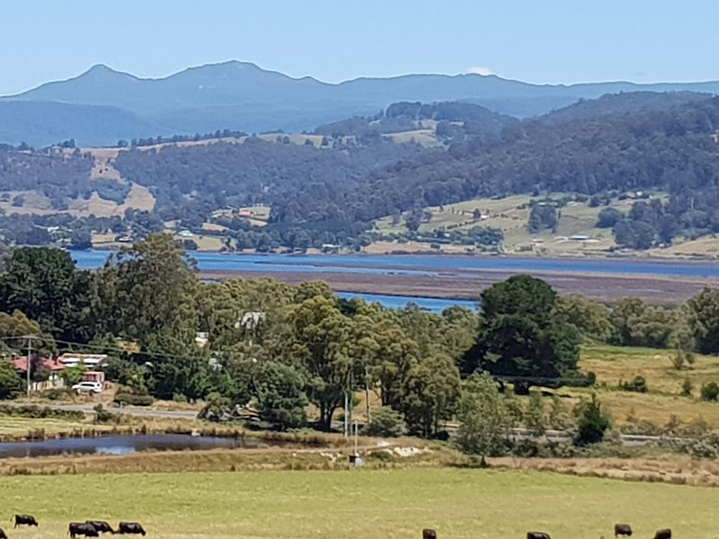 Looking out over our farm across the Huon River towards the Hartz Mountains.