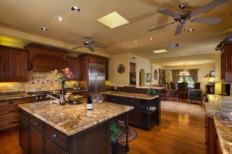 Gourmet kitchen with granite counters and quality appliances.