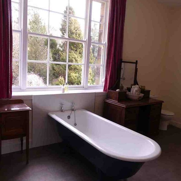 Relax in the tub after a day exploring the estate ..