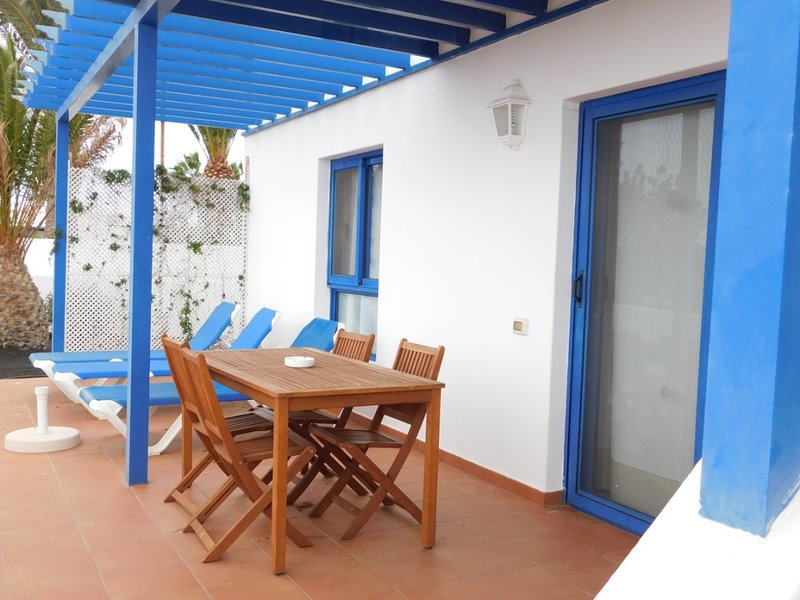 Views of the terrace of the two-bedroom villa located in front of the sea with garden.