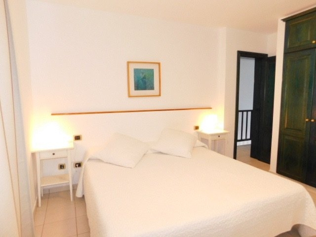 Room 1. Large bedroom with two beds, balcony and sea views.