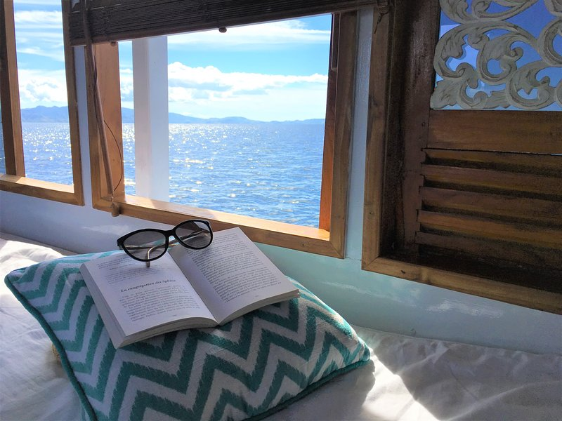 Reading a book with a sea view