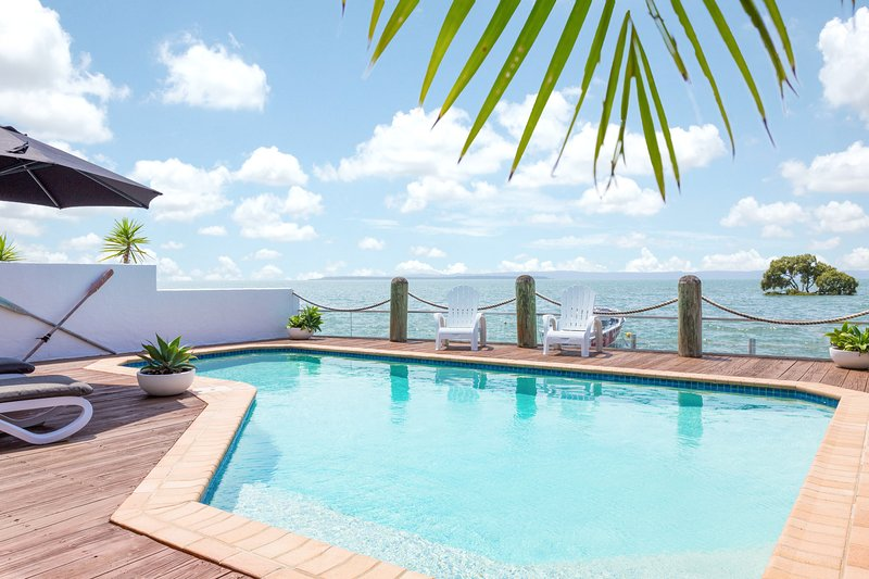 Unwind overlooking magnificent Moreton Bay whilst relaxing poolside
