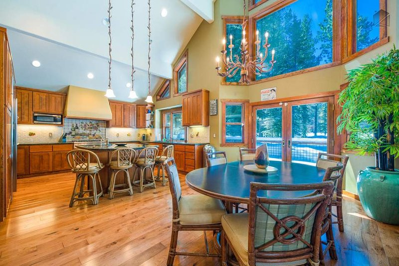 Step onto the patio from the dining area, which shares an open floor plan with the kitchen.