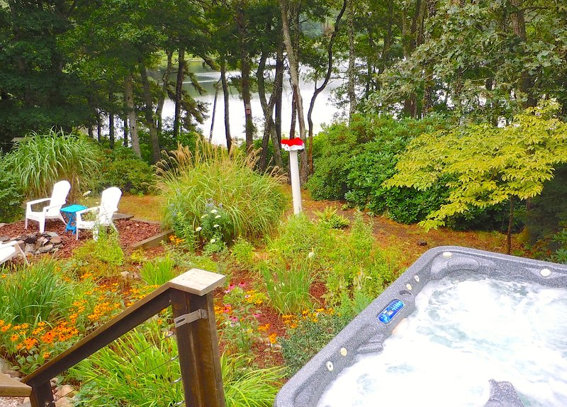 Hang out in the hot tub or around the fire pit - both with a pretty pond view.