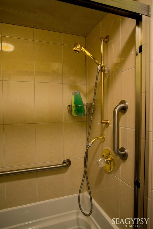 The showers are tiled with grab bars