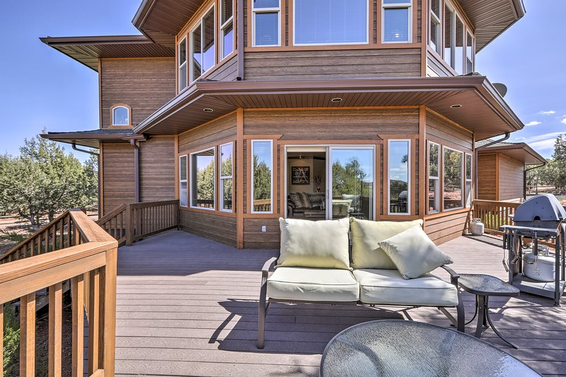 This 1-bed, 1.5-bath house sleeps 5 and features scenic views from the deck.