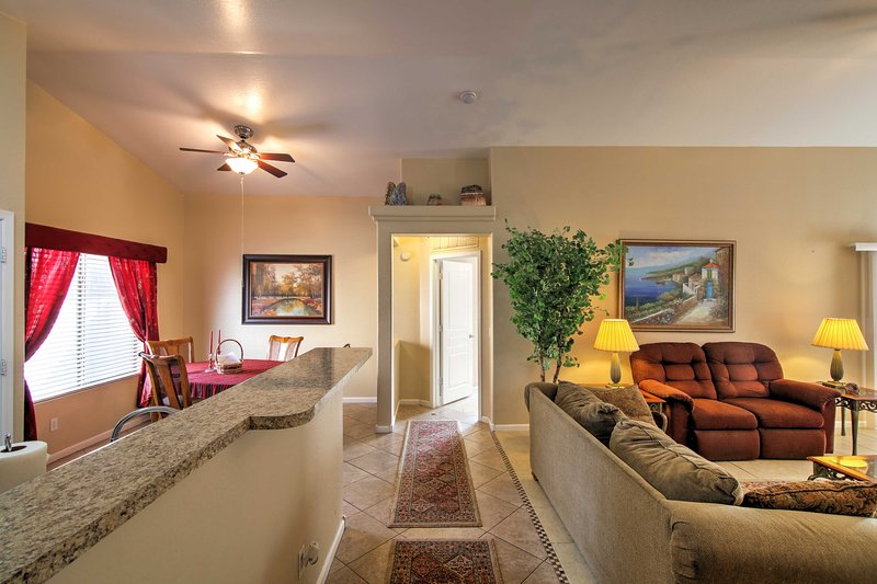 The living room opens seamlessly to the kitchen.