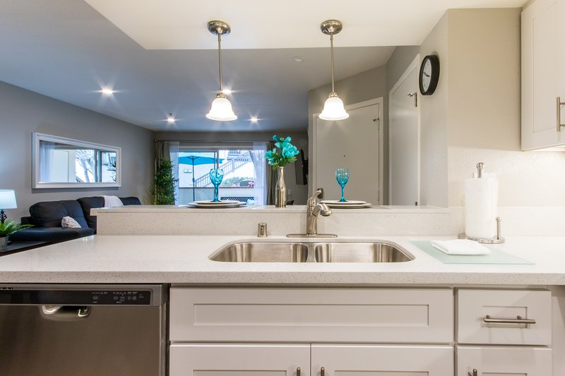 This open floor plan with all new kitchen cabinets and counter tops is a delight.