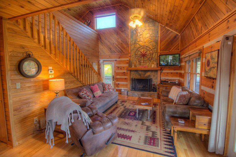 Sweet Retreat Living Room with Soaring Stone Fireplace, Flat Screen TV