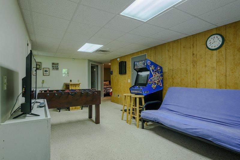 Sala de jogos com futon