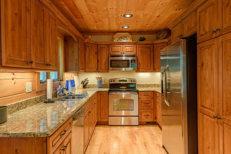 Cheerful Kitchen with Granite and Stainless