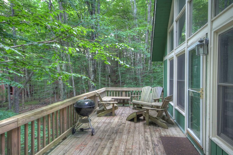 Benzine Farm Deck with Charcoal Grill and Adirondack Chairs