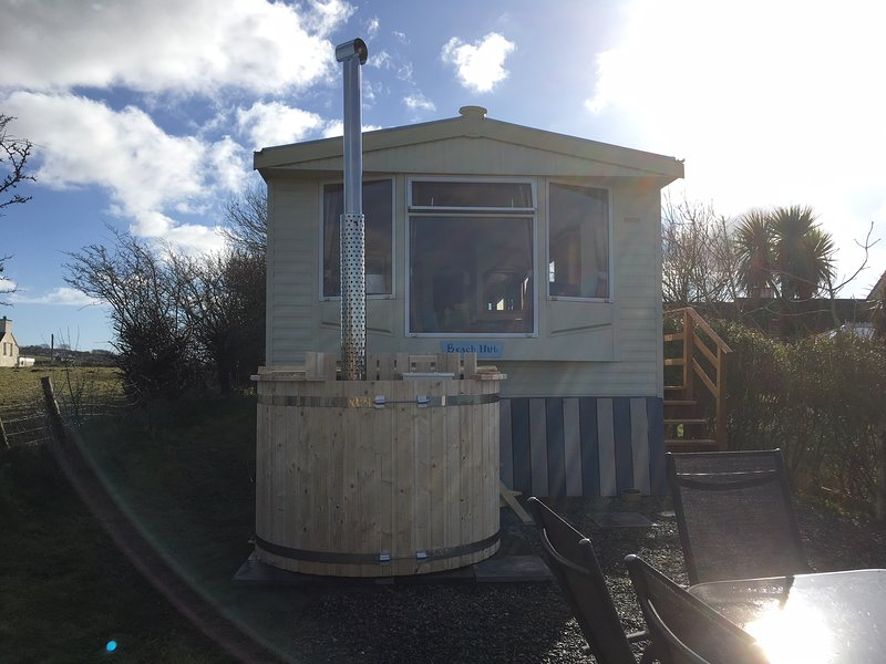 The Beach Hut and it's private wood fired hot tub - perfect for relaxing!