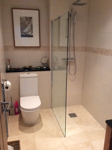 Wet room with underfloor heating and 'rain' shower.