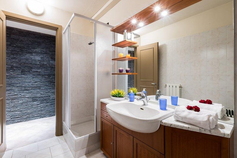 Shower and handbasin provided