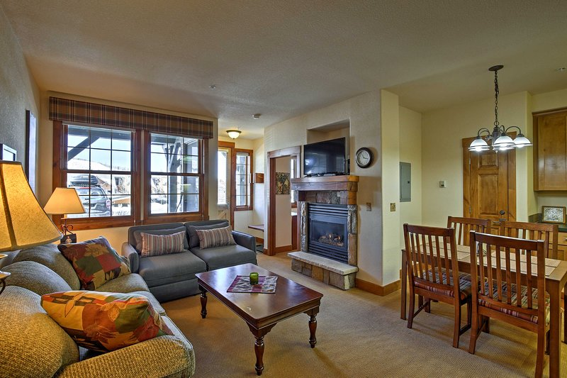 Unwind with a cup of hot cocoa and a roaring fire in this vacation rental condo.