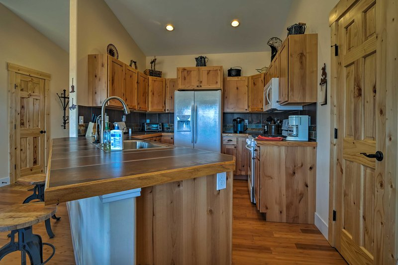 The fully equipped kitchen includes everything needed for home-cooked feasts.