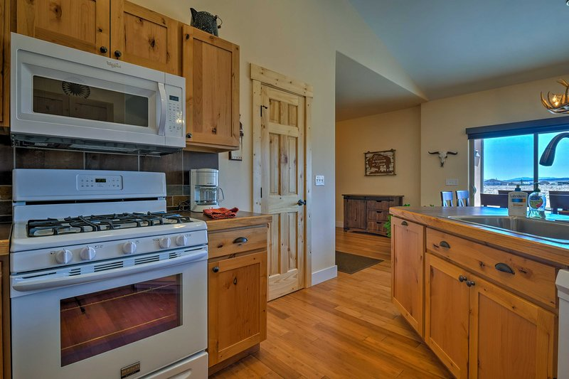 Ample counter space and all the essential appliances make cooking a breeze.