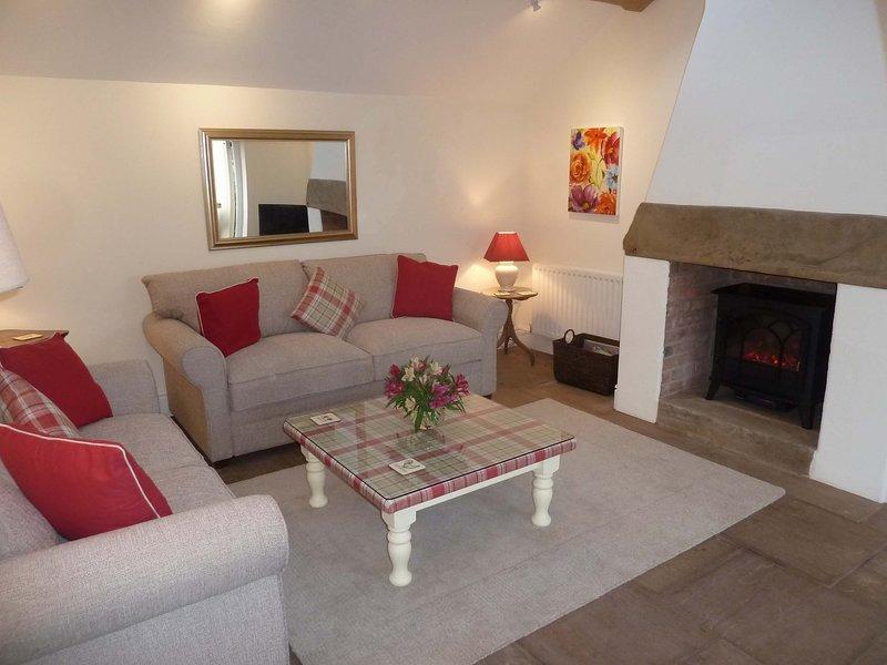 sala de estar em Golly Cottage