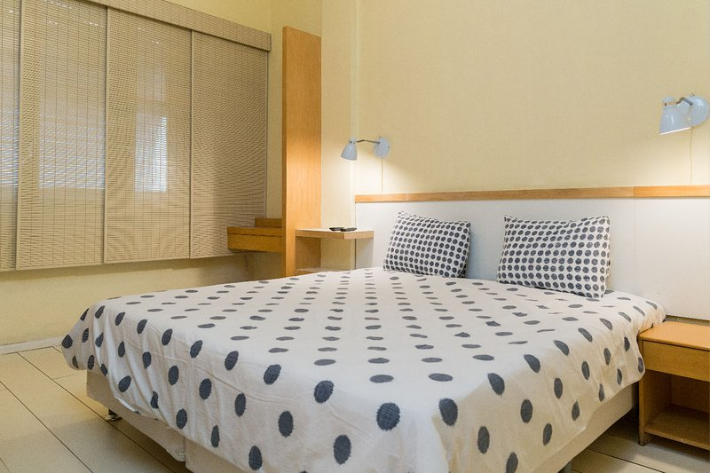Wide bed in room with air conditioning