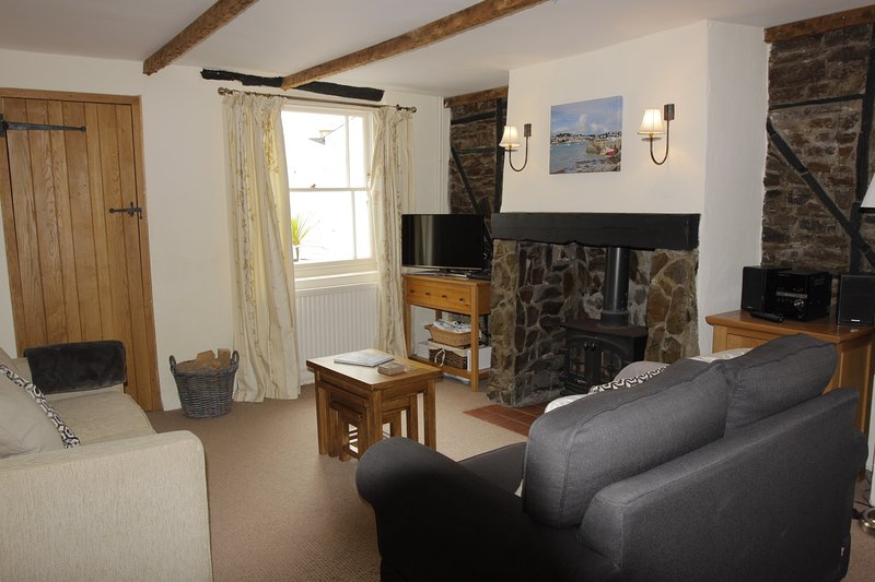 The cosy sitting room with log-burner