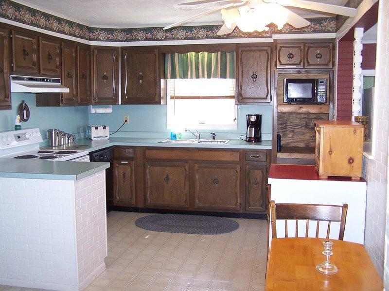 Kitchen includes dishwasher, blender, coffee maker