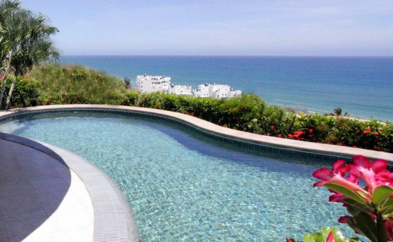 Shared pool with outstanding views and privacy hedge.