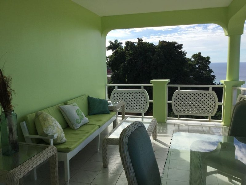 Several balconies with gorgeous views of the caribbean sea and the airport.