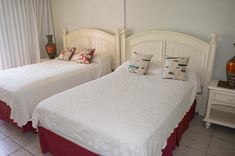 Bedroom 2. Has 2 double size beds, queen length.
