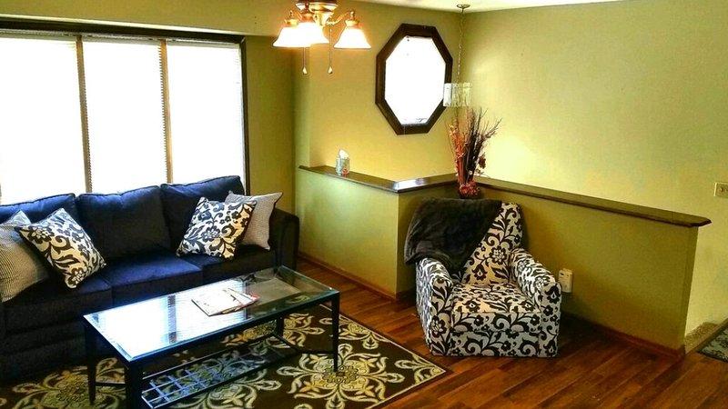 Living area on the top floor. Hardwood floors with bay window