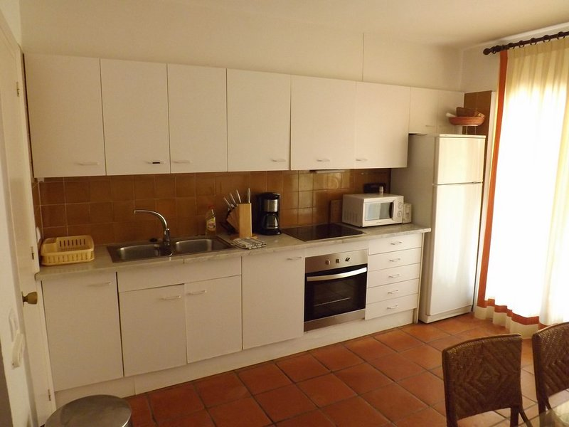 kitchen and dining room with access to terrace-SA PUNTA COSTA BRAVA