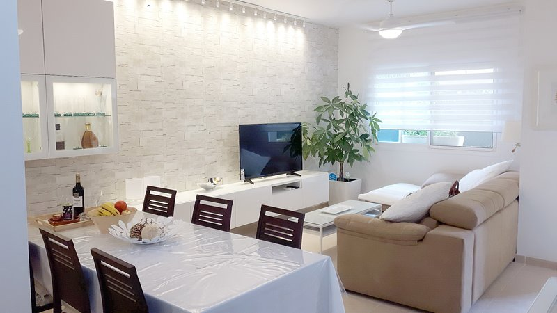 """Living room: large sofa with chaise longue, Smart TV 49 """"table for 6-8 persons A / C and ceiling fans."""