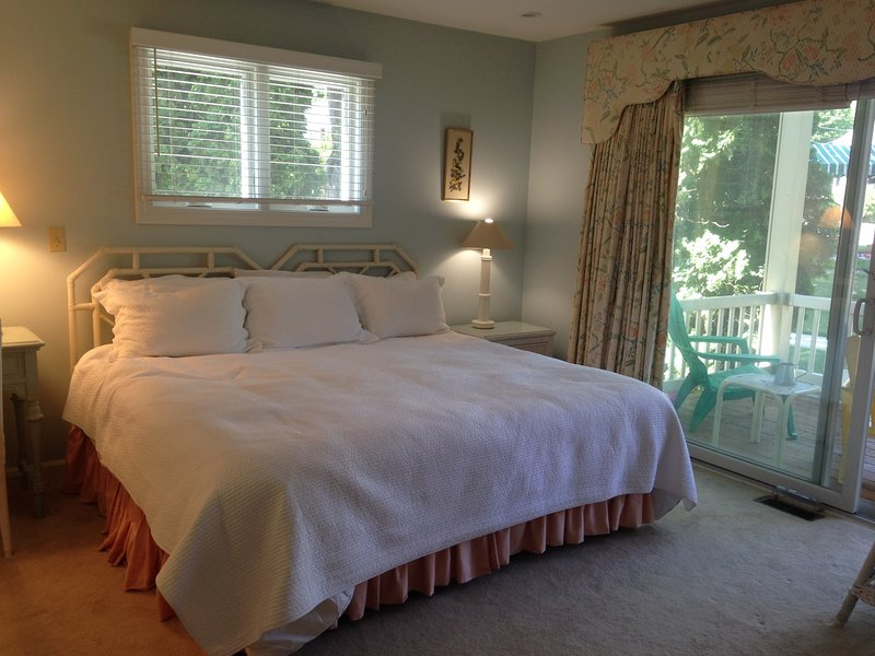 Master bedroom/makeup area opens to deck facing Colonial Inn  Bikes may be kept on deck-very safe!