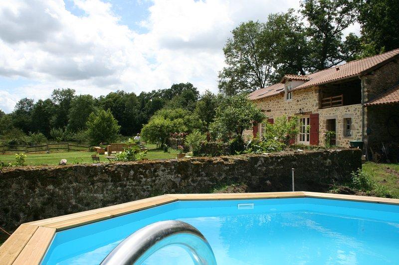 Gîte building and pool at Le Moulin de Pensol.