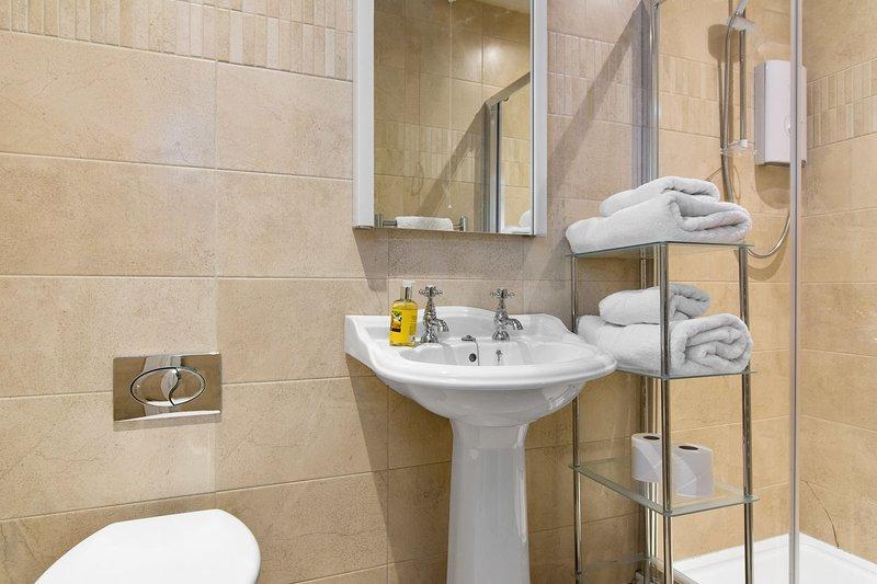 The Linen Room's en suite bathroom has a walk-in electric shower.