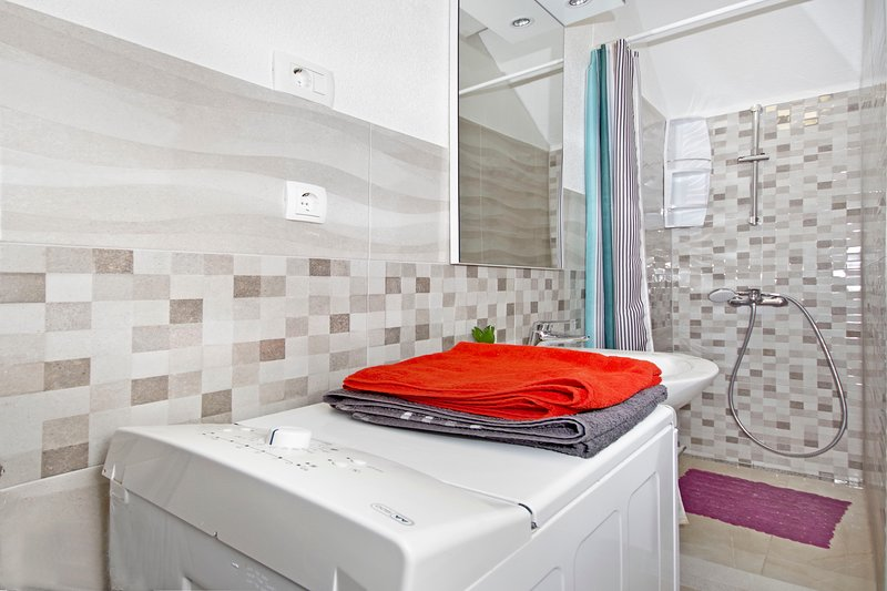 Bathroom with walk in showe