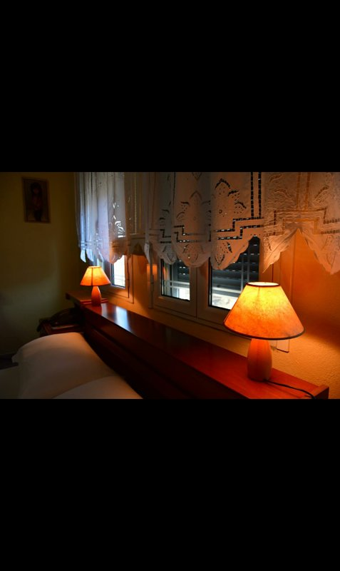 One of the bedrooms equipped with a private bathroom in it.
