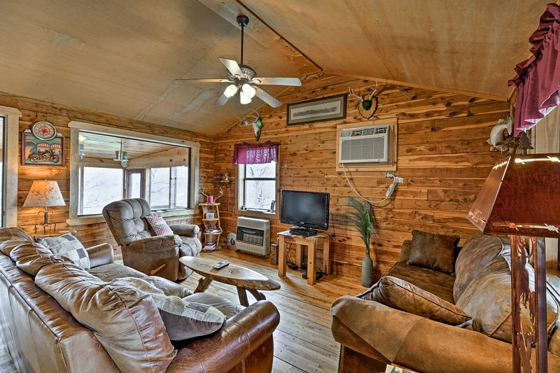 This quaint cabin comfortably sleeps 5 and is filled with rustic charm.
