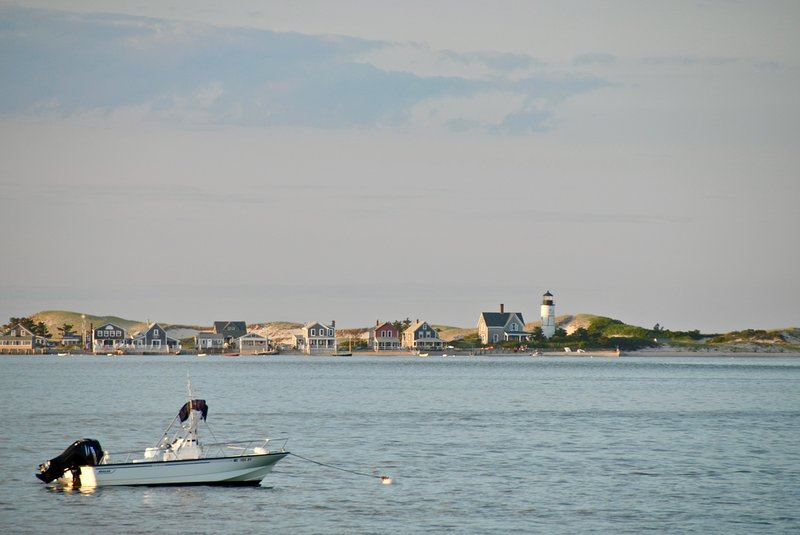 There's Sandy Neck Lighthouse, right across the harbor!