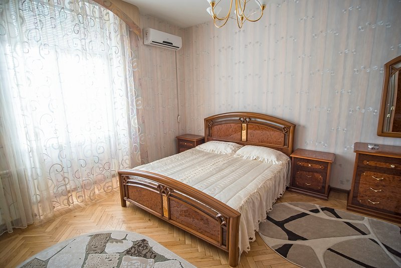 Bedroom has king-size bed and large wardrobe