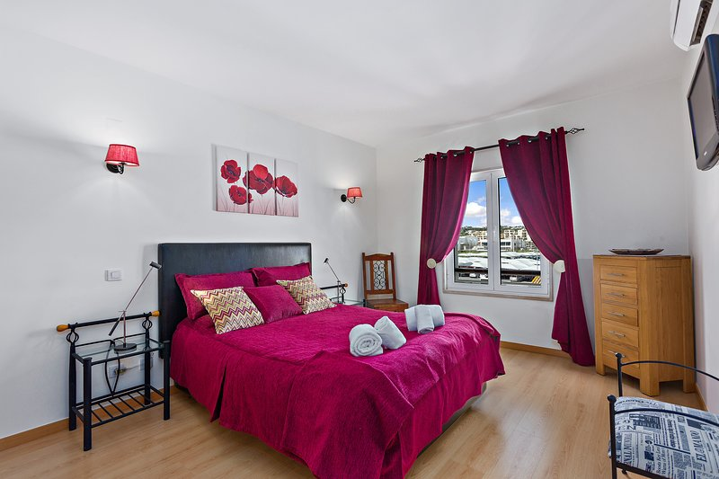 The spacious Master bedroom with TV and Ensuite.