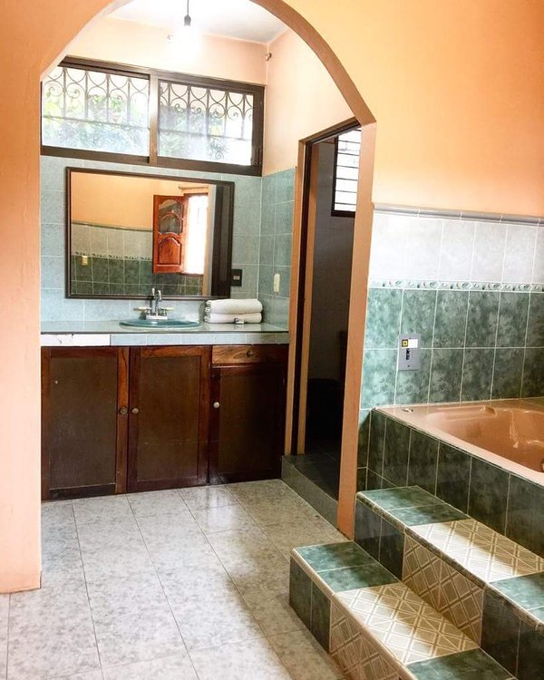 Lux Room private bathroom with tub and shower