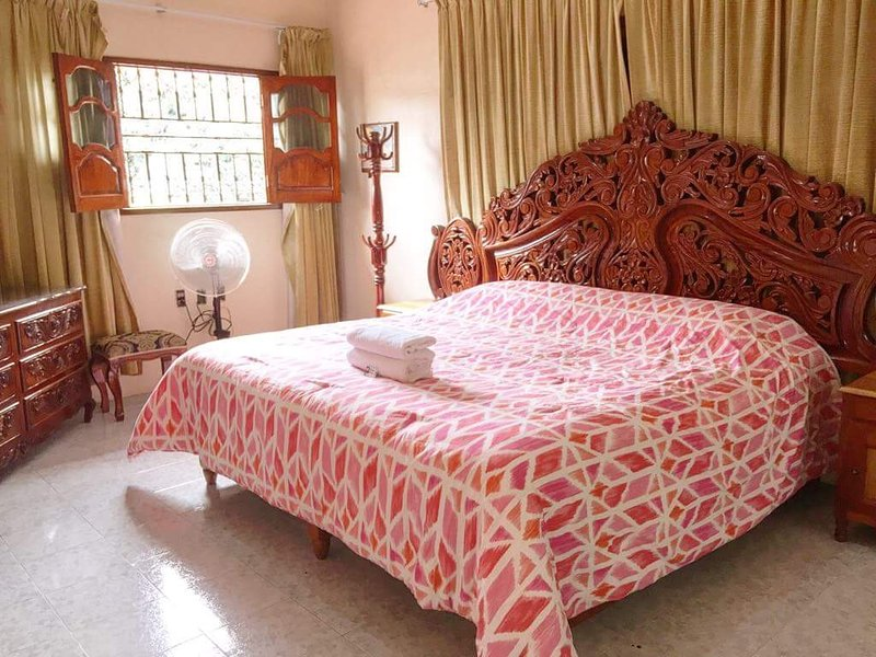 King size bed in room Lux