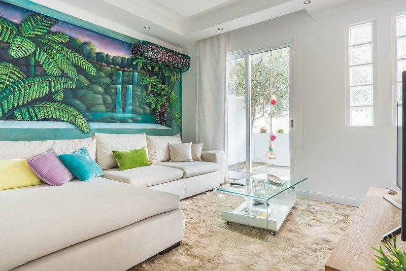 living room with a beautiful landscape of the island, painted by renowned Argentine artist Marcos Milewski