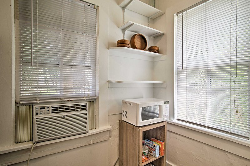 The unit has 2 window air-conditioners.