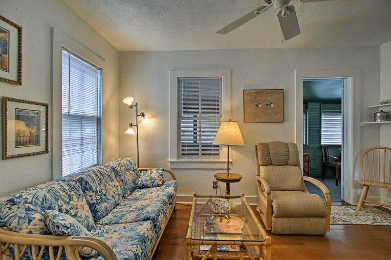 The unit features tall ceilings and newly painted walls.