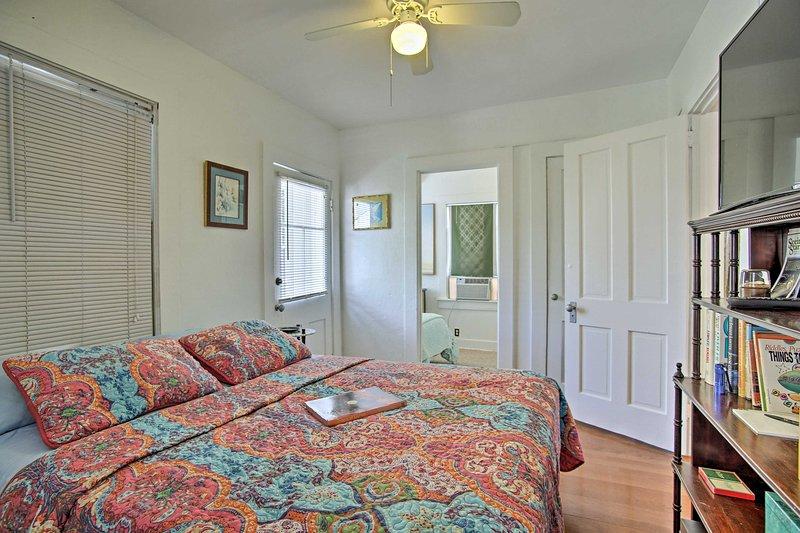 Get comfortable on the queen mattress in the bedroom.