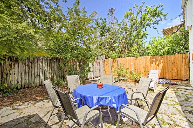 Enjoy eating dinner on the shared patio with your loved ones.