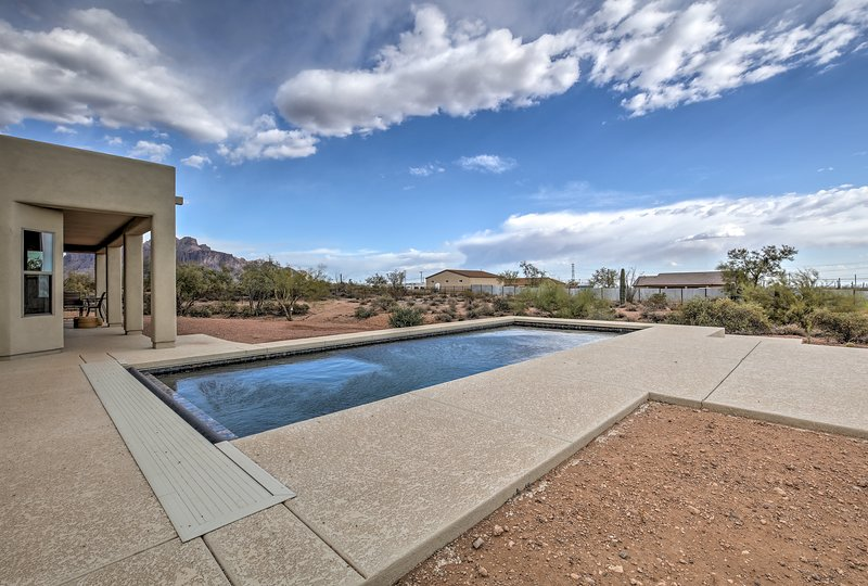 Enjoy views of Superstition Mountain from the pool of your vacation rental home.